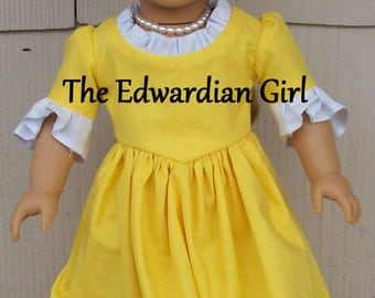 Colonial day dress. Fits 18 inch play dolls such as American Girl, Springfield, OG. Yellow and white 1770s dress. Made in USA