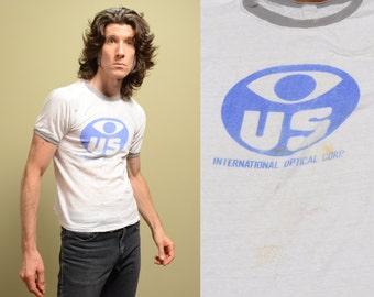 vintage 70s 80s thrashed ringer shirt t-shirt International Optical Corp distressed punk skate vintage 1970 1980 eye logo tee S M