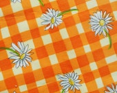 Vintage 1970s printed highquality unused synthetic fabric with large oxeye daisy flower pattern on checkered light yellow/orange bottomcolor