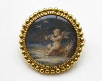 Antique French Hand Painted Miniature of a Cherub Playing a Horn in the Woods 18K Brooch