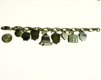 Sterling Silver Charm Bracelet And Eight Charms