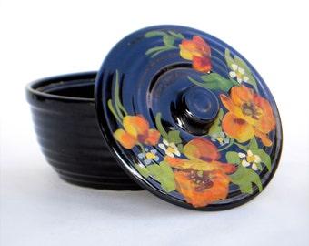Hand painted, lidded baking dish.  Black glazed ceramic lidded dish, orange flowers, tortillas warmer