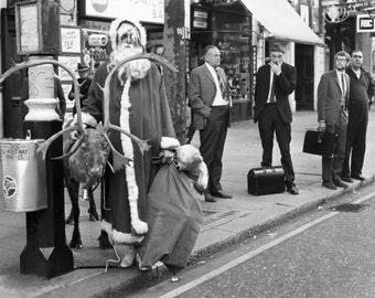Santa waiting for bus circa 1950
