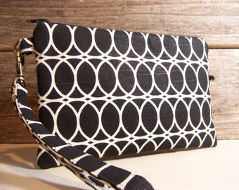 Large Wristlet in a black modern circle fabric , smart phone wristlet , wallet with zipper, bag for cell phone.