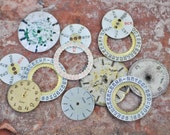 Mix of vintage watch parts,number rings,dials.