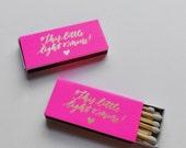 a pair of mini gold foil + neon pink matchboxes