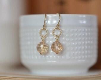 gold earrings. small gold earrings. swarovski crystal earrings. sparkly gold earrings. gold ring earrings.