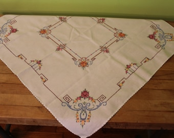 Handmade cross stitched vintage tablecloth flower design