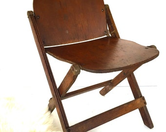 Vintage wooden folding chair 18th Engineer Co by American Seating Co. c1940.