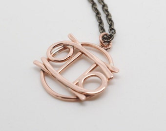 Gemini cancer zodiac necklace in polished copper
