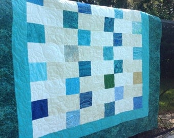 Pieced Blue and Cream Quilt