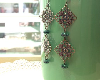 Antiqued brass and Czech green glass long dangle earrings