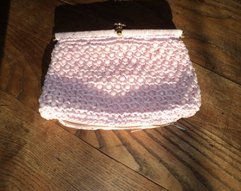 Vintage Pastel Pink Crochet Raffia Palm Sized Clutch Hand Bag with lucite like pink plastic beads sewn into design in Very Good Condition
