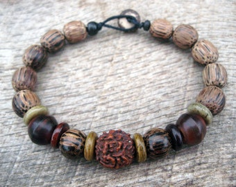 Mens bracelet, rudraksha seed, horn, bone and palm wood beads, handmade, earthy natural materials, on strong cord with toggle and loop clasp