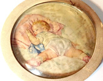 Vintage sleeping baby round bubble glass picture
