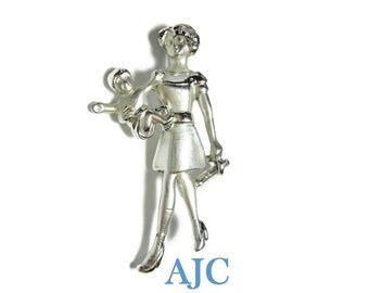 AJC mother brooch, working mother child, articulated briefcase, silver tone gloss and matte finish, VIP on briefcase, dress and high heels