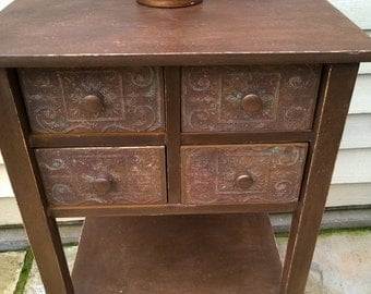 Hand painted rust effect, four drawer side cabinet