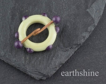 Ivory and purple lampwork glass toggle clasp.