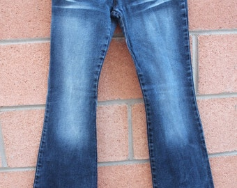 Lowrise blue denim jeans with flair leg waist size 26