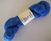 Eman Sock.  100gm hand-dyed fingering weight yarn.  Feeling Blue