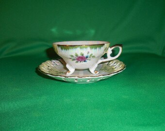 "One (1),  Tilso, 2 1/8"" Porcelain, Footed Tea Cup & Saucer, with Pearl Iridescent Lusterware Finish."
