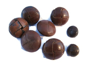 real leather buttons with leather shanks in two sizes, 6 large and 2 small.