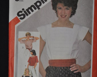 Vintage Simplicity pattern 5899, Blouse pattern sizes 10-12-14, New UNCUT pattern Misses' lose fitting pullover tops in two lengths