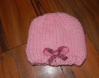 SALE hand knitted baby girl hat, hand knit baby girl cap pink with a leopard print bow newborn