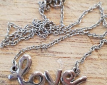 Love necklace, words to wear over your heart
