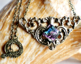 Triangle bronze filigree necklace with square dichroic glass cabochon.
