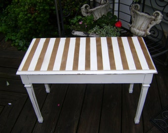 vintage bench with gold stripes