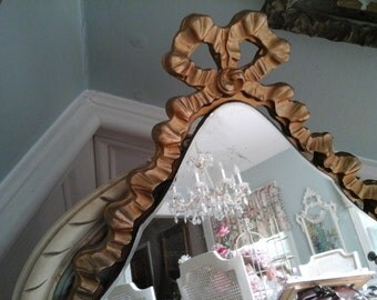 Pretty vintage mirror with bow