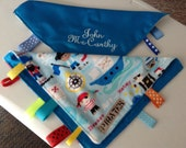 A mini Blankie or lovey ,Minky and satin. Comforts child when in car ,stroller or take to daycare .