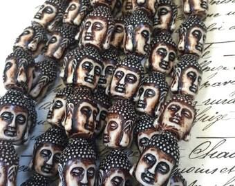 1 strand Meduim size Buddha heads, 8 heads included, white/tan Budha heads,  brown accents, full Buddha heads, double sided, tan buddha head
