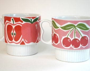 Pair of Vintage 1960s Fruit Themed Stacking Mugs Mod Graphics Cherries and Apples in Red and Pink