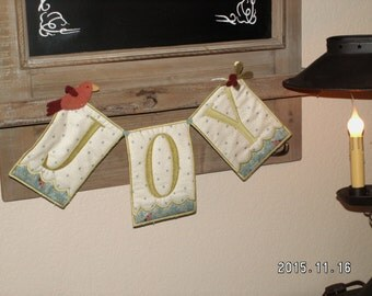 Joy Christmas banner with hand dyed wool accents