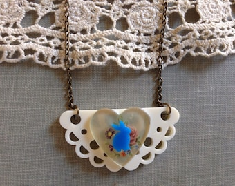 Plastic necklace with blue bunny and flowered heart