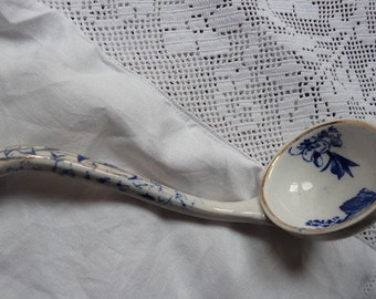 a small blue and white sauce ladle from 19C, gilded edge