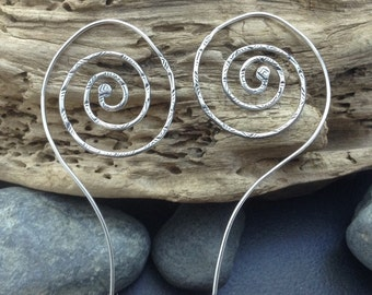 Large sterling silver spiral earrings, hammered textured metalwork with a long wavy undualting ornamental sterling silver ear wire