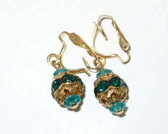 Vintage green and gold filigree clip earrings.