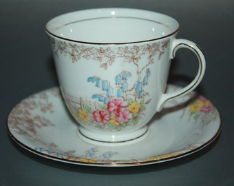 "BELL Fine China Teacup and Saucer ""Memories"""