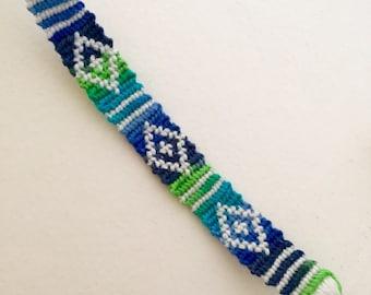 Green, blue, and black aztec pattern friendship bracelet