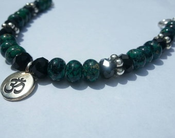 Ohm bracelet beautiful green beads with black beads and silver toned spacers