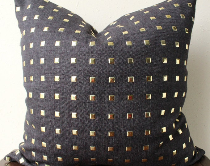 black and gold studded pillow with metal gold studs