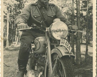 Soldier on motorcycle antique photo