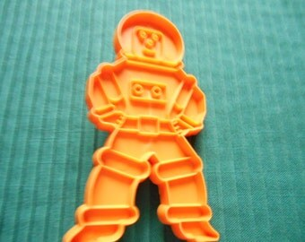 Orange Vintage Spaceman Cookie Cutter from Stanley Home Products. 4.75 inch by 2 5/8 inch