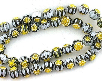 8mm  black / white / yellow  flower glass bead strand
