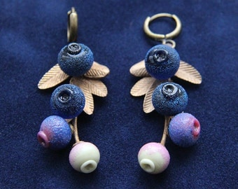 Long earrings with glass lampwork blueberries and bronze branchlets