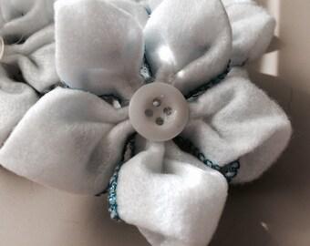 White felt flower