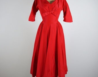 Scarlett Red Vintage 1950's fit and flare Dress by Harry Keiser with half sleeves, V-Neck and front bow detail